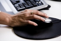 Hand of woman on computer mouse